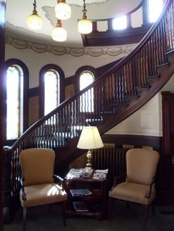 Winding staircase inside the law office of Your Injury Attorneys.