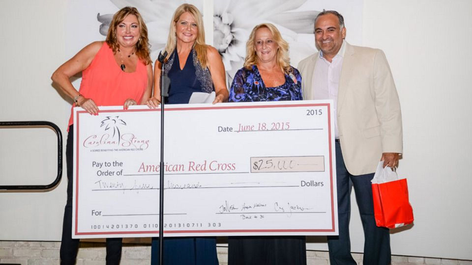 Photo of Back to 30™ team with check for the Red Cross