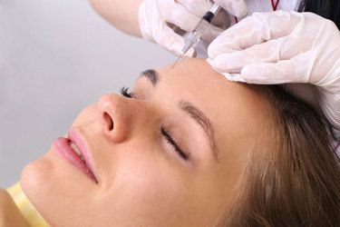 Photo of a woman receiving a dermal filler