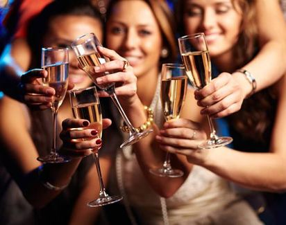 Smiling woman clinking champagne glasses together
