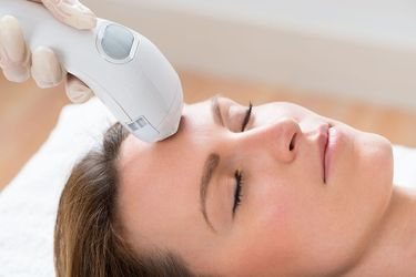 Woman undergoing Ultherapy treatment