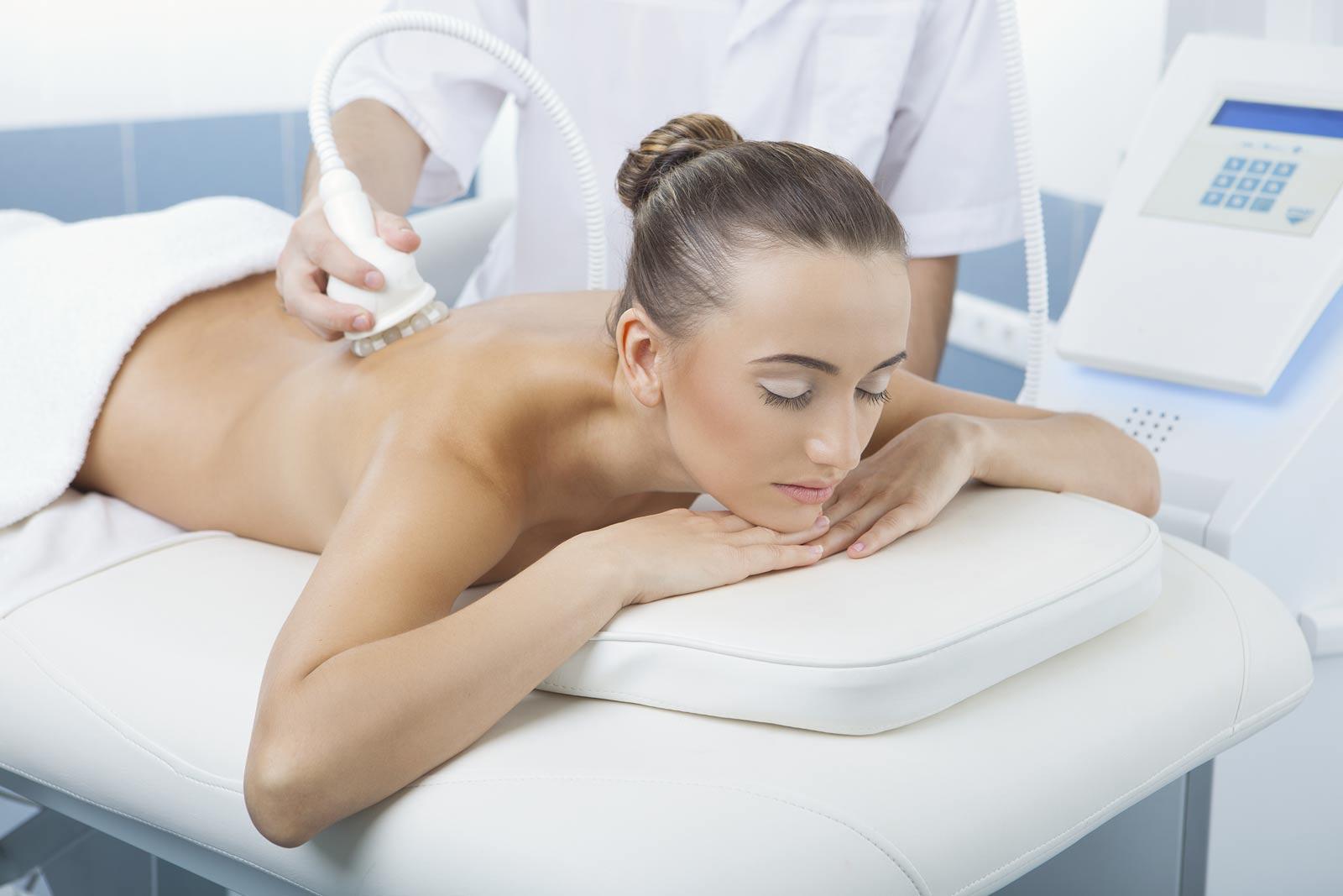 Woman undergoing UltraShape treatment