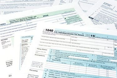 Several sheets of 1040 tax forms.