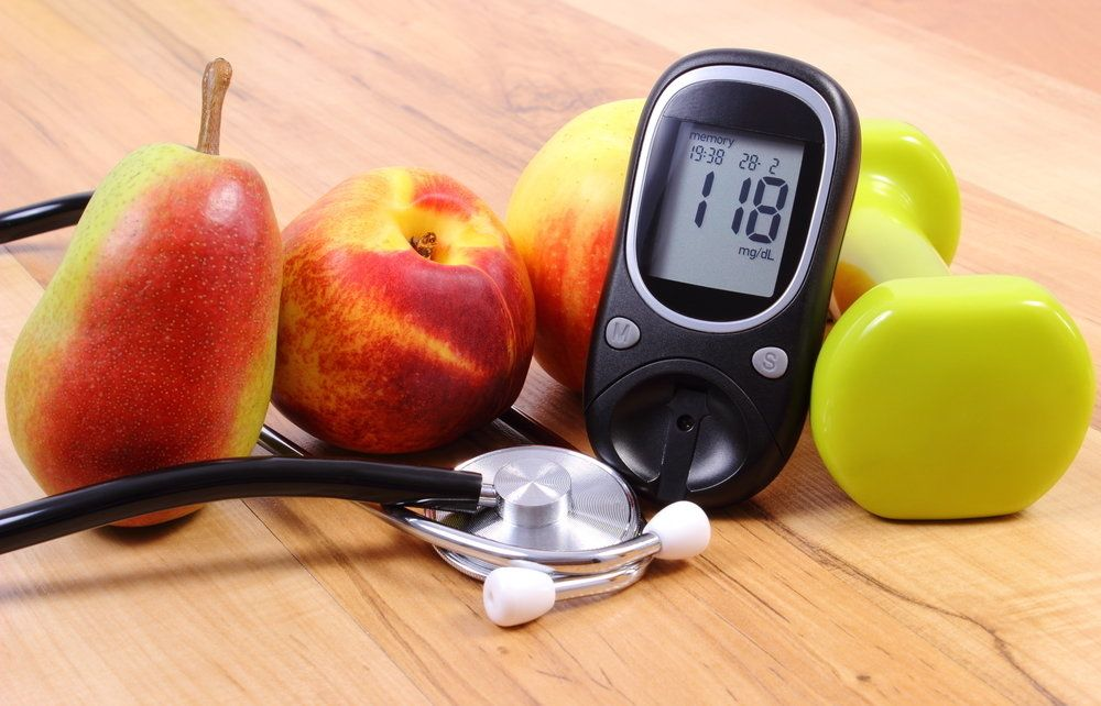 Photo of weights, apples, and health monitor