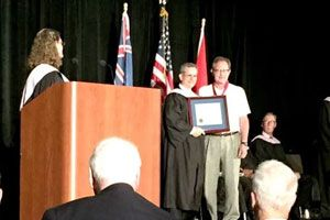 Dr. Gary B. Dempsey receiving honor