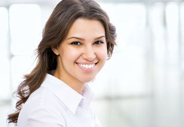 Brunette woman looking right and smiling