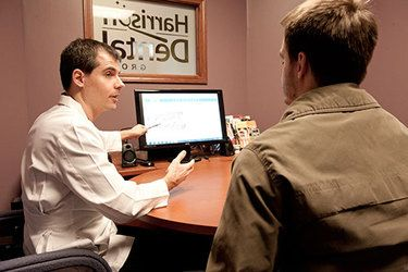 Dr. Harrison consulting dental implants patient