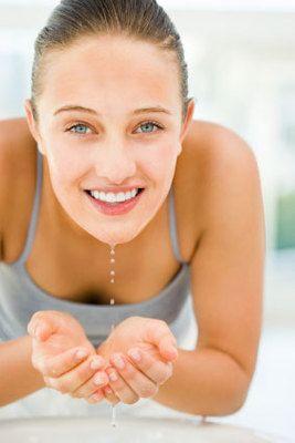 Smiling girl washing face