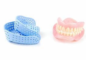 Photo of a dental mold and dentures