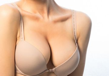 A woman's breasts in a tan bra