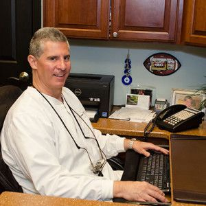 Dr. John W. Dovgan smiling