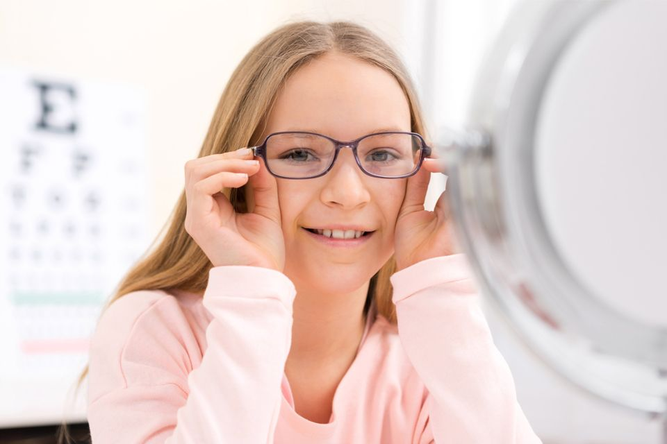 Photo of a young girl with glasses