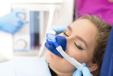 A woman receiving nitrous oxide sedation
