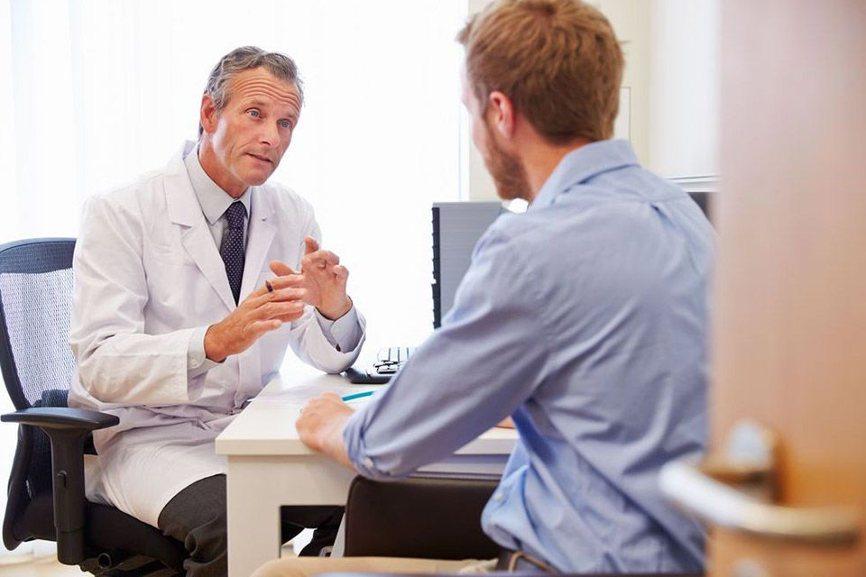 Photo of a doctor consulting with a patient