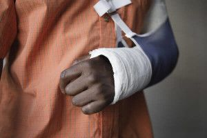 person with injured arm