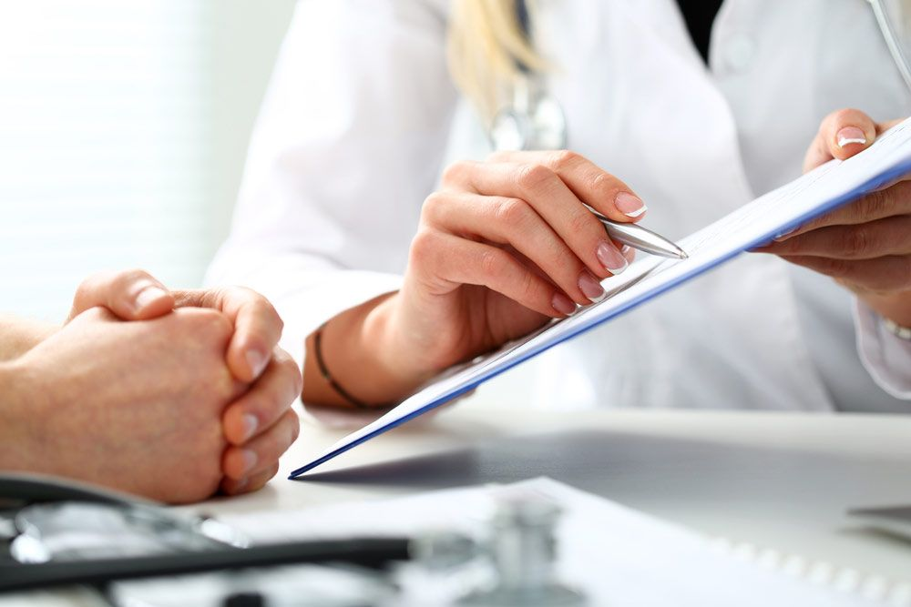 Medical professional and patient reviewing paperwork
