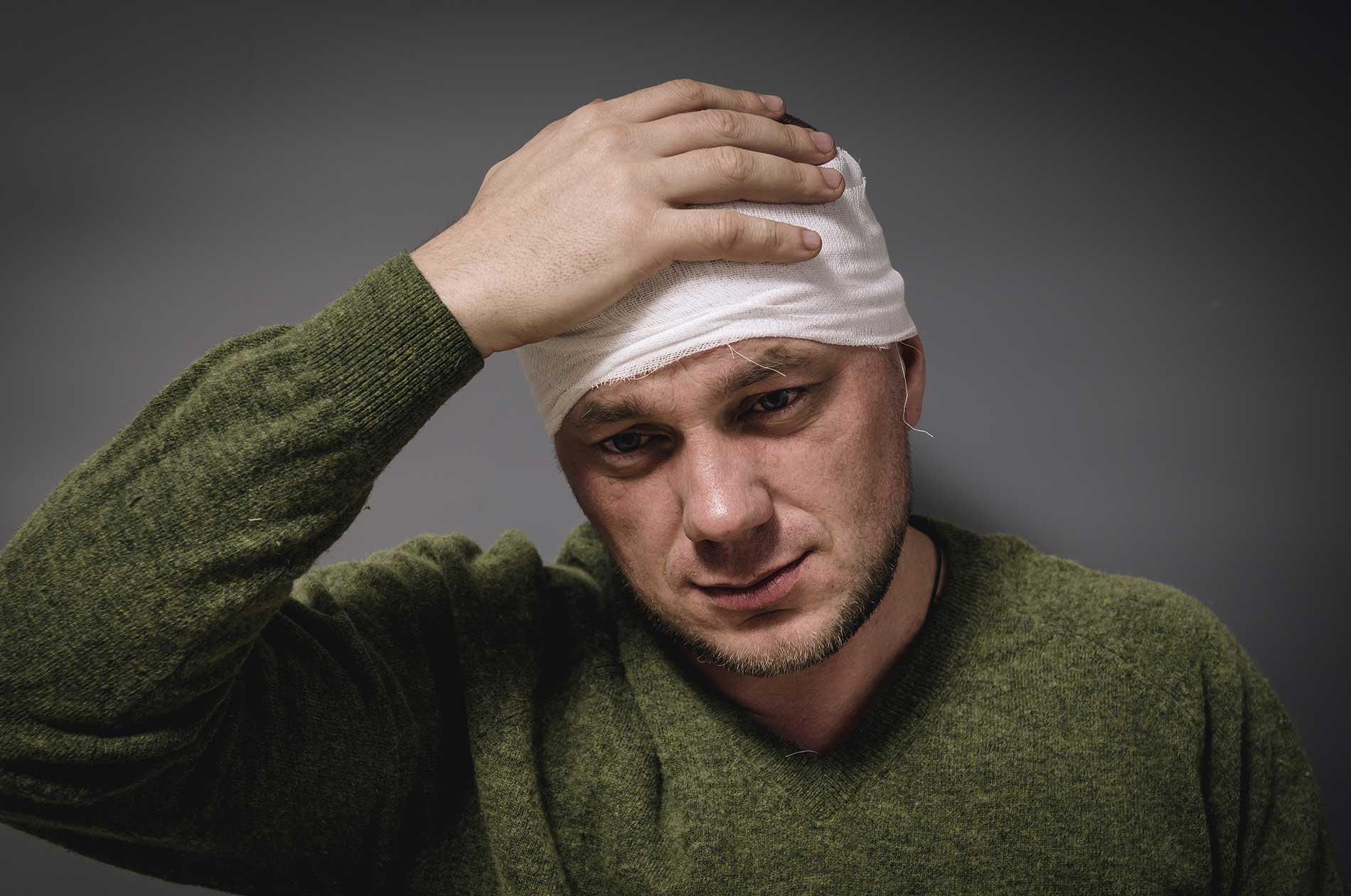 A patient with a bandage on his head.