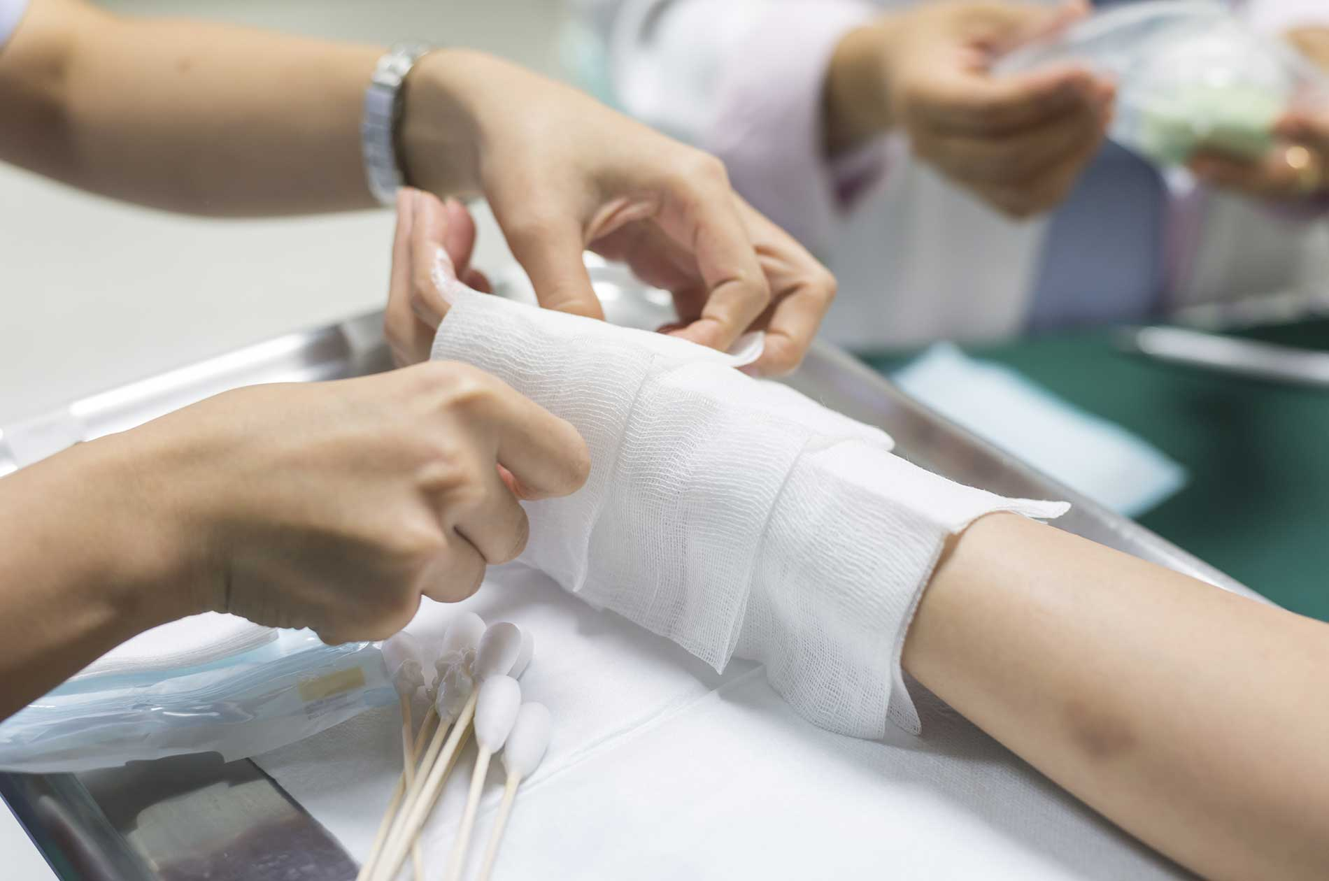 A doctor treating a patient's burn injury.