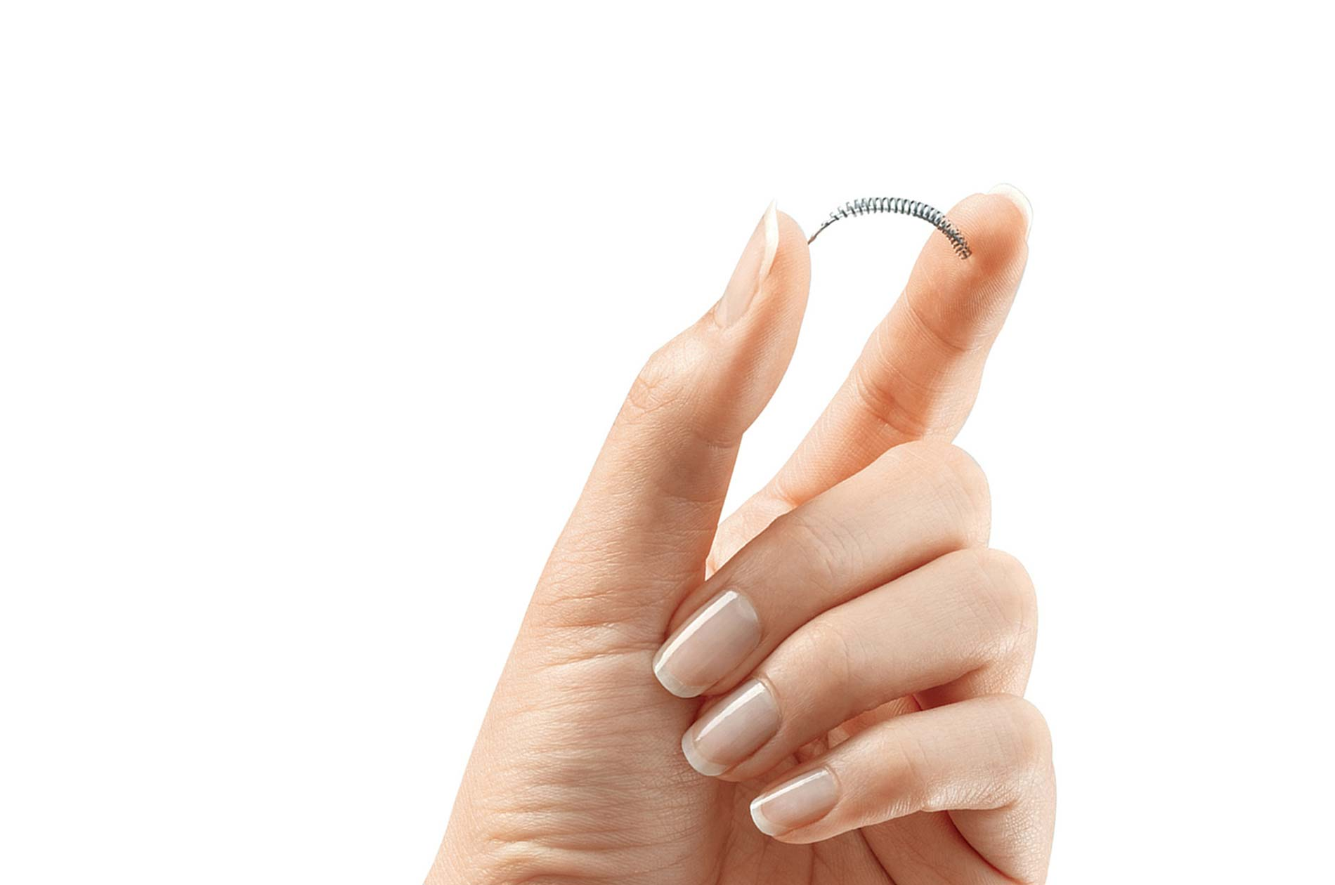 Patient holding an Essure coil