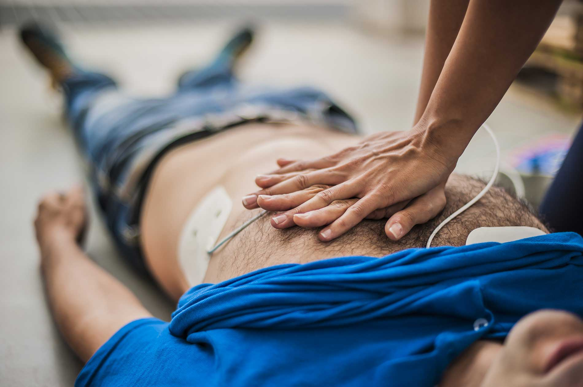 A nurse performing chest compressions on a patient