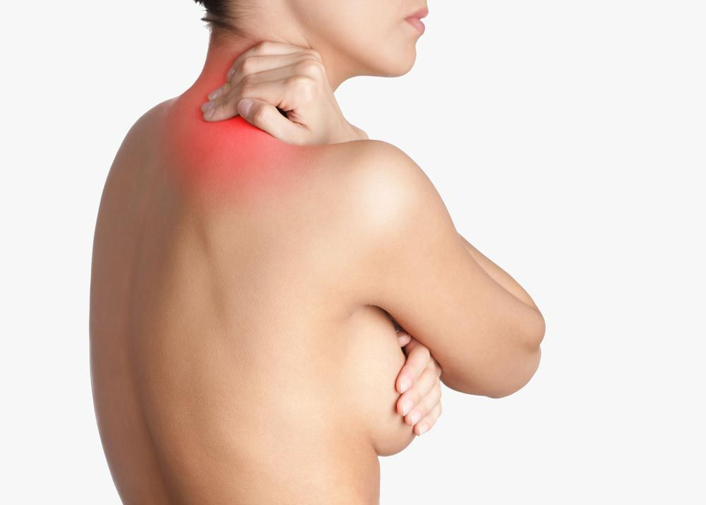 a woman holding her neck in pain