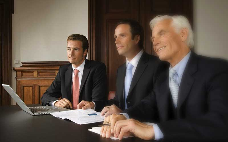 Men in suits at table