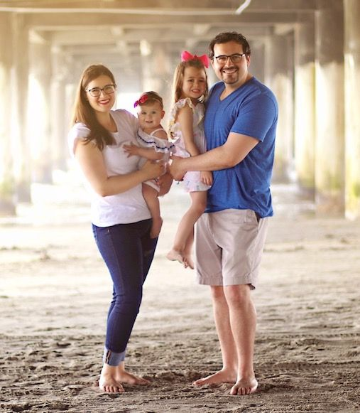 A picture of Dr. Joshua Manuel and his family at the beach