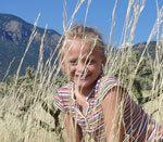 Blonde girl in a field