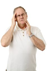 Man with Headache and Jaw Pain