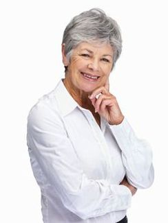 An elderly woman shares a smile.