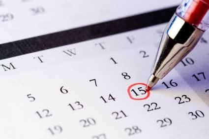 Pen circling date on calendar