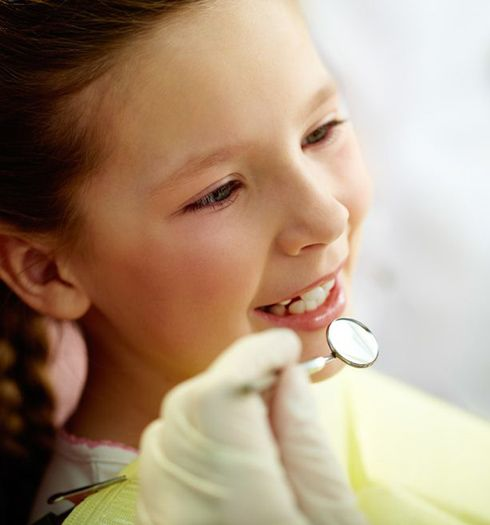 Smiling young girl at dental exam
