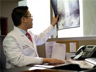 Dr. Mark Hong examining an x-ray