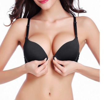 Breast augmentation patient in black bra.