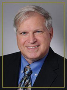 Dr. John E. Seylar