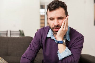 A man suffering from a toothache.