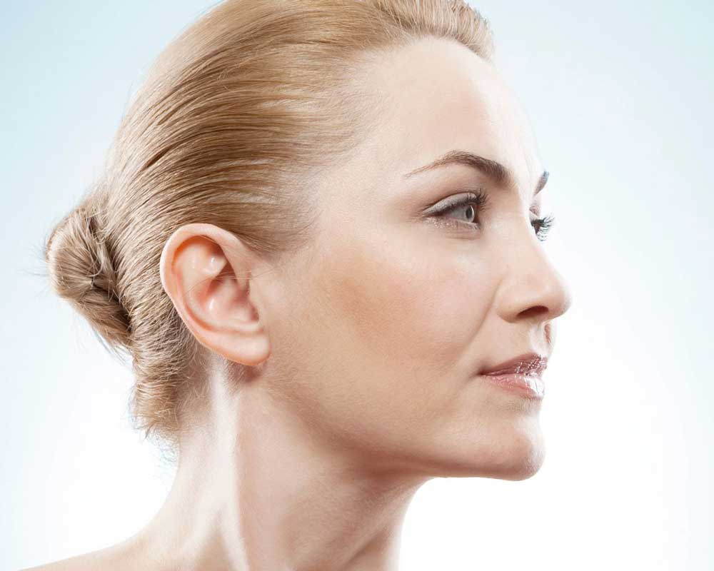 Beautiful older woman with hair pulled into bun