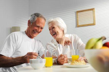 An elderly couple having breakfast