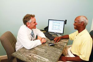 Dr. Burden and a male patient
