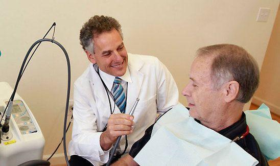 Dr. Burden prepares to work on a patient.