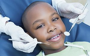Young boy in dental chair smiling