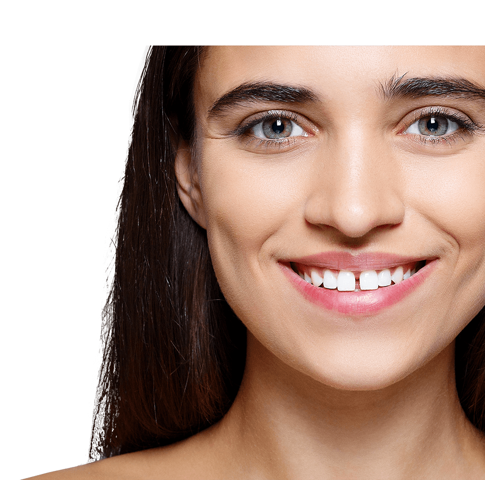 Attractive smiling woman with gap between her front teeth
