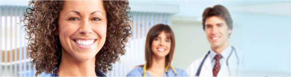 A doctor and two nurses smile at the camera