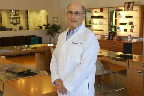 Dr. Moshe Mendelson in the optical store.