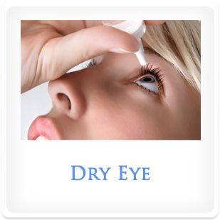 A woman applying eye drops to her eye.