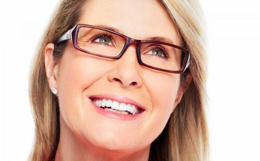 A blonde woman wearing eyeglasses.