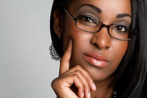 A young woman wearing eyeglasses.