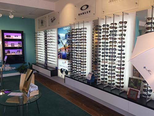 A wall of eyeglasses and sunglasses at our optical store