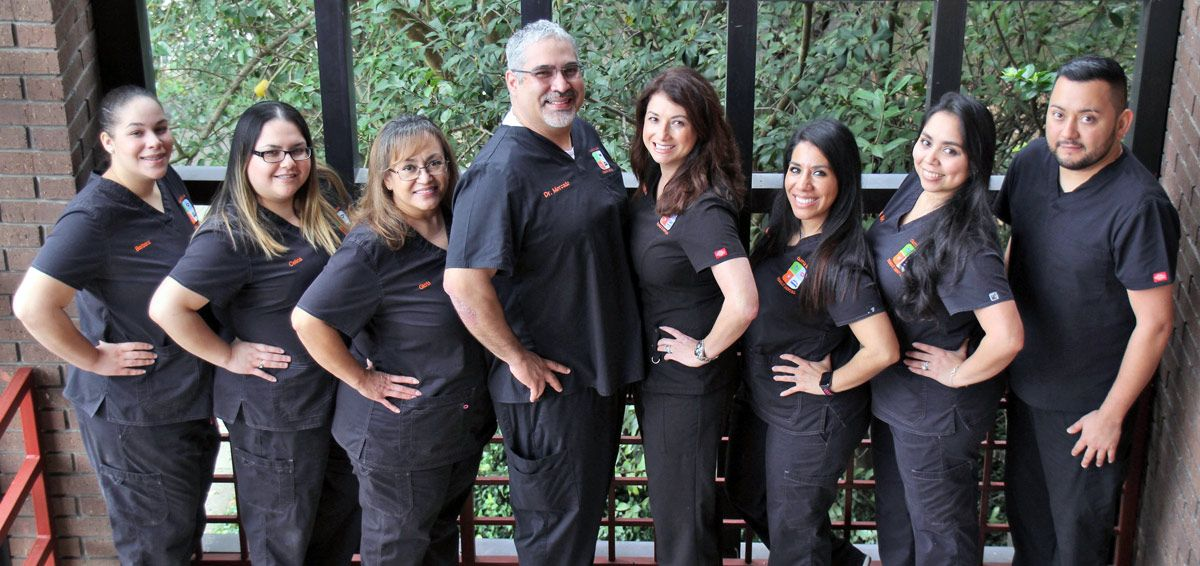 Dr. Mercado and staff at Castle Hills Family Dental