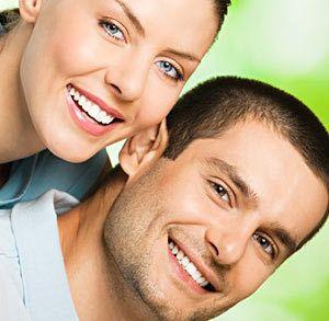 Man and woman smiling at the camera